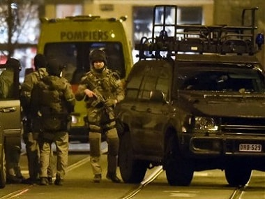Police during a raid in Brussels. AP