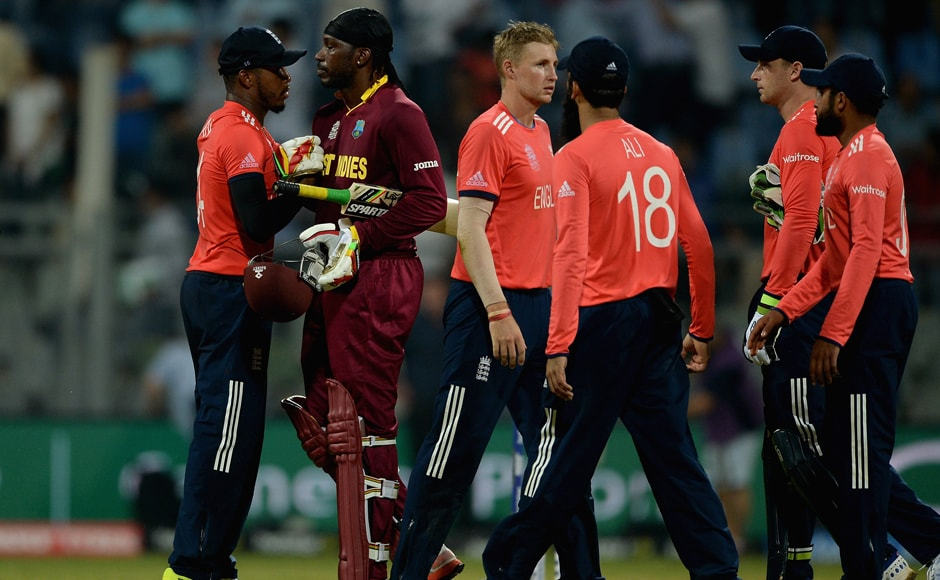 Chris Gayle (second from left) shakes hands with members of the England team after West Indies chased the target down. Getty Images