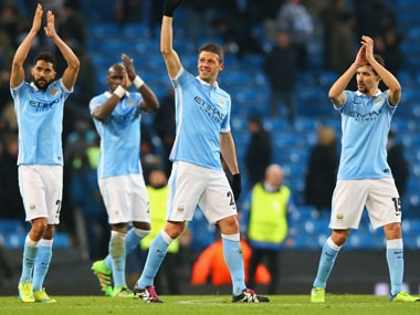 Manchester City players are jubilant after reaching the Champions League quarterfinals in front of home fans at The Etihad in Manchester on Tuesday. AFP