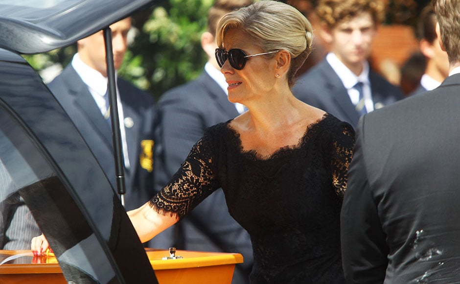 Martin Crowe's wife, Lorraine Downes, bids farewell to the former New Zealand cricketer during his funeral at the Holy Trinity Cathedral in Auckland. AFP