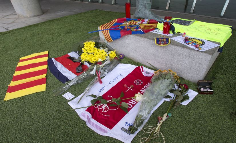"FC Barcelona football club fan memorabilia is displayed in honor to the late Dutch soccer great Johan Cruyff at the Camp Nou stadium in Barcelona, Spain, Friday, March 25, 2016. Dutch soccer great Johan Cruyff, who revolutionized the game as the personification of ""Total Football,"" died Thursday . He was 68. (AP Photo/Fernando Viros)"