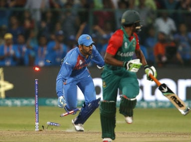 Dhoni runs out the last Bangladesh batsman to help steal a one-run win for India in Bengaluru on Thursday. Reuters