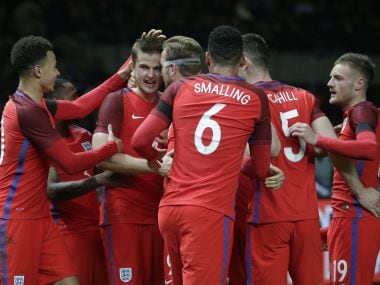 Eric Dier celebrates with his teammates after scoring England's third goal. AP
