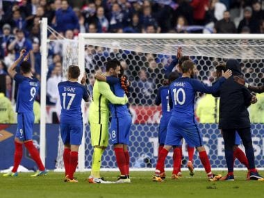 France' players celebrate after defeating Russia. AP