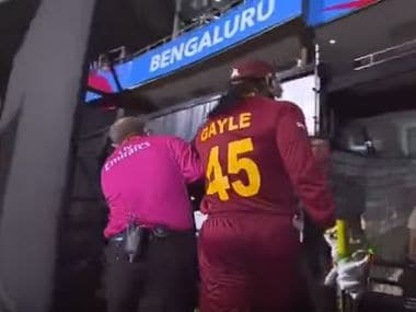 Chris Gayle being dragged away from the field by the umpire. Screengrab from YouTube