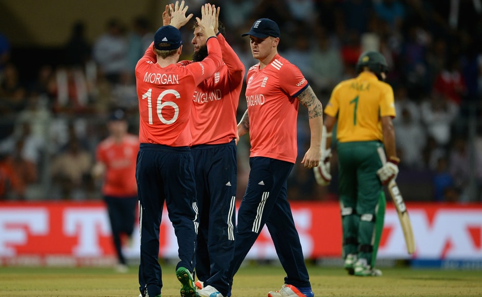 Moeen Ali of England celebrates with captain Eoin Morgan after dismissing Hashim Amla. Getty Images