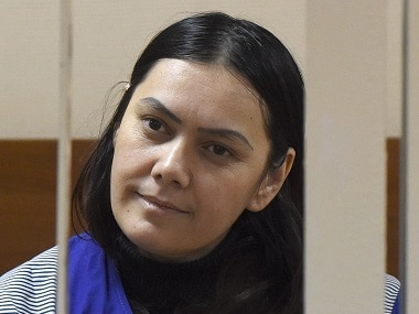 Gyulchekhra Bobokulova looks out from a defendants' cage during a hearing at a court in Moscow.  AFP