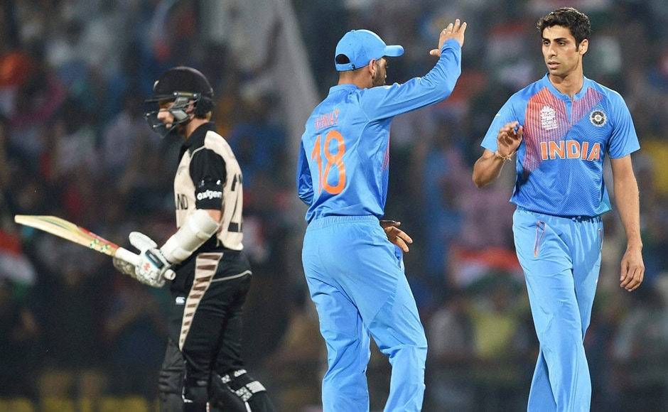 Ashish Nehra (right) celebrates after dismissing Colin Munro for 7. PTI