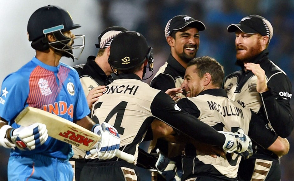 Shikhar Dhawan (left) walks back to the crease after getting trapped leg-before off the bowling of Nathan McCullum. PTI
