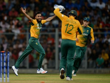 Imran Tahir (left) celebrates with his South African team-mates after dismissing Ajinkya Rahane. Getty Images
