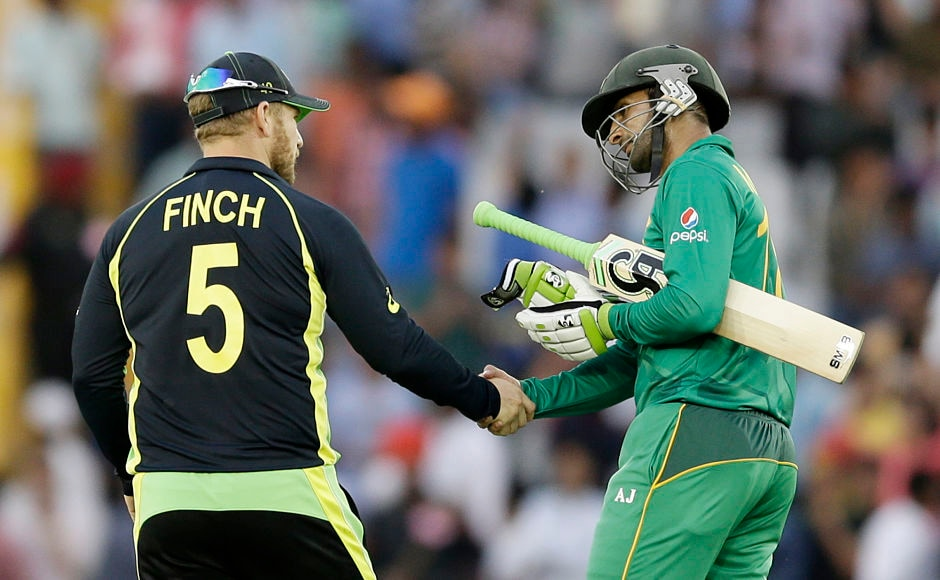 Wishing Australia luck to knock India out? Pakistan's Shoaib Malik shakes hands with Australia's Aaron Finch after the WT20 game on Friday. AP