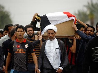 Iraqi relatives and friends mourn the victims of a suicide bomb attack.
