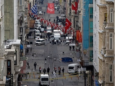 Emergency services at the scene of the explosion, on a street, in Istanbul. AP