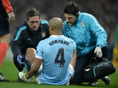 Vincent Kompany receives medical treatment before leaving the pitch injured. AFP