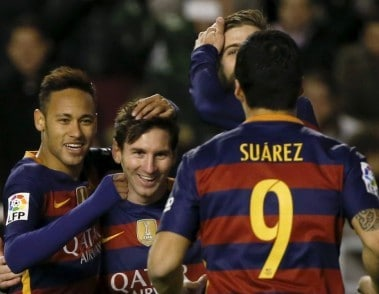 Barcelona's Lionel Messi celebrates with team mates Luis Suarez and Neymar. Reuters