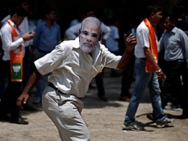 Masks of Narendra Modi are flying off the shelves this Holi. Reuters