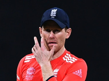 Eoin Morgan reacts after West Indies's Chris Gayle hits a boundary . AFP
