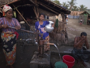 Rohingya women and men gather at the Thel-Chaung displacement camp in Sittwe located in Rakhine State. AFP