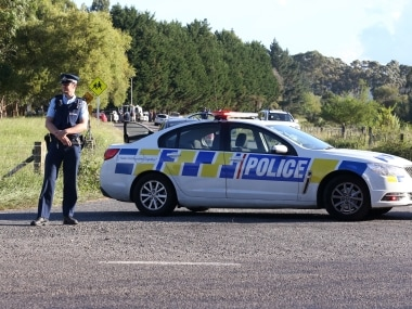 Police block a road near Kawerau, New Zealand, after police officers were shot. AP
