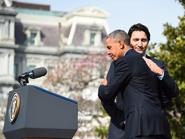 US President Barack Obama and Canada's Prime Minister Justin Trudeau hug during a welcome ceremony during a State Visit on the South Lawn of the White House. AFP