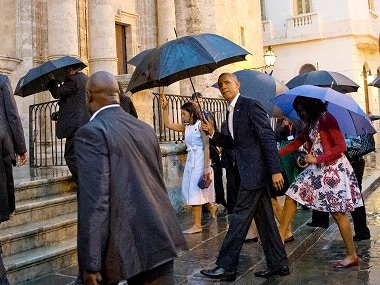 President Barack Obama and first lady Michelle Obama visit la Catedral de La Habana on Sunday. AP