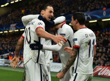 PSG striker Zlatan Ibrahimovic celebrates with teammates after scoring against Chelsea at the Stamford Bridge on Wednesday. AFP