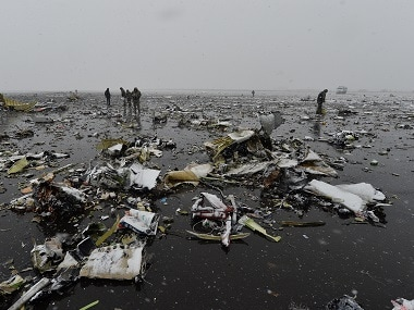 File image of Russian Emergency Ministry employees investigating the wreckage of the crashed plane at the Rostov-on-Don airport. AP