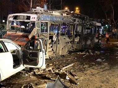 Damaged vehicles at the scene of an explosion in Ankara on Sunday. AP