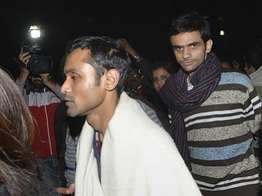 Umar Khalid (C) and Anirban Bhattacharya (L).  AFP