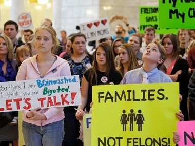 Polygamy advocates protest laws making polygamy a felony in Utah. AP