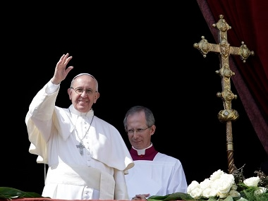 Pope Francis delivers the Urbi et Orbi (to the city and to the world) message at the end of the Easter mass, in St. Peter's Square, at the Vatican. AP