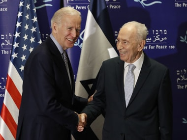 US Vice President Joe Biden (L) shakes hands with former Israeli president Shimon Peres during a meeting on March 8, 2016 at the Peres Centre for Peace in Tel Aviv. Biden will hold talks with Israeli Prime Minister Benjamin Netanyahu and Palestinian president Mahmud Abbas. AFP