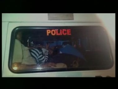 The accused in the police custody. Image credit Twitter/ibnlive