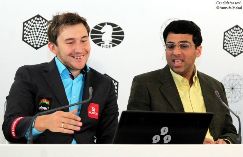 Karjakin (left) and Anand at the post-match media conference. Amruta Mokal