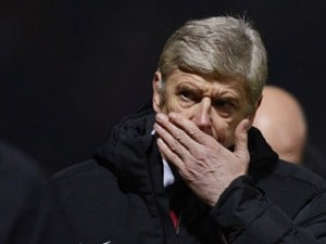 Arsenal's coach Arsene Wenger reacts during their English League Cup soccer match against Bradford City in Bradford, northern England December 11, 2012. REUTERS/Nigel Roddis (BRITAIN - Tags: SPORT SOCCER CAPITAL ONE CUP)