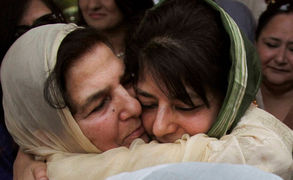 New Jammu and Kashmir Chief Minister Mehbooba Mufti, hugs her mother Gulshan Ara Nazir after Mufti took the oath of office during a ceremony in Jammu. PTI