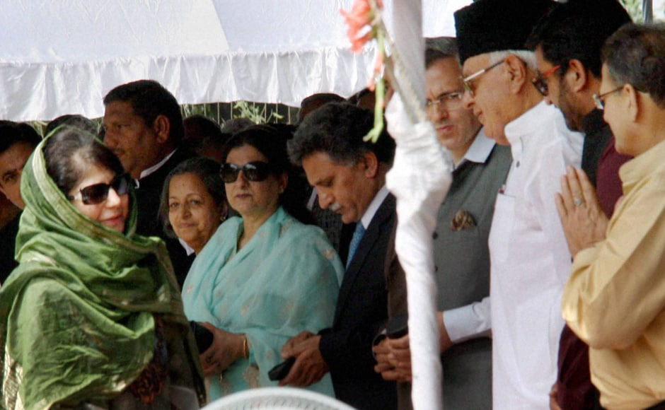 New Jammu and Kashmir Chief Minister Mehbooba Mufti exchages greetings with former Union Minister Farooq Abdullah, former J&K chief minister Omar Abdullah and other guests after taking oath at Raj Bhawan in Jammu. PTI