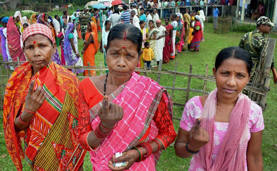 Tea tribe women show their inked fingers after casting their vote during the first phase of the Assembly Elections for Duliajan Assembly Constituency at Bordubi in Assam on Monday. PTI