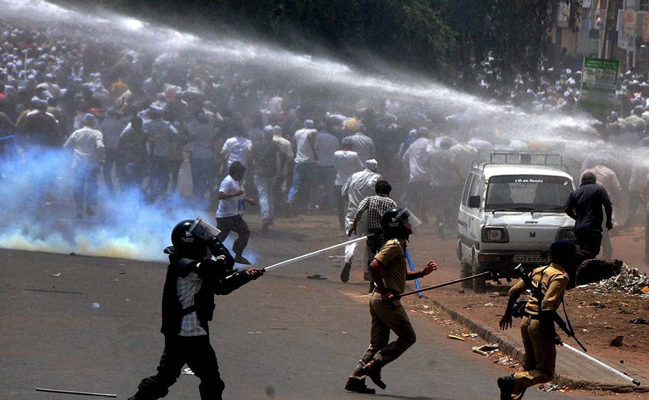 "The police uses a water canon to control members of Patidar community during their ""Jail Bharo Andolan"", demanding the release of Hardik Patel in Mahesana on Sunday. PTI"