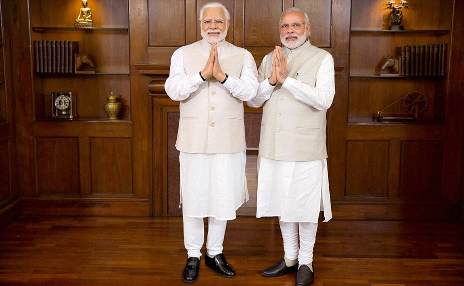 Prime Minster Narendra Modi poses with his wax statue due to be placed at London's Madame Tussauds museum, in New Delhi. Three of his wax statues have been installed in Singapore, Hong Kong and Bangkok and one of them will be put up in London in the next eight days. PTI