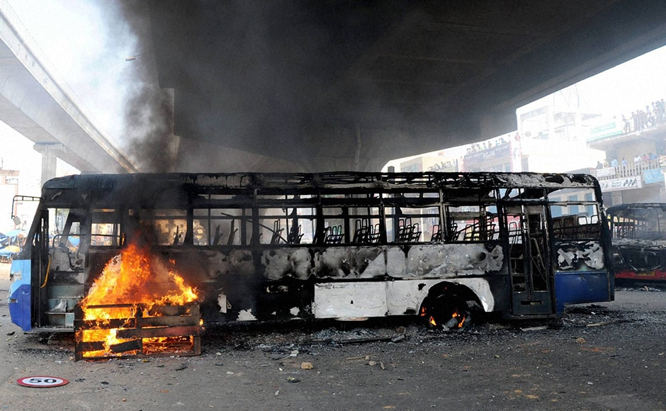 Irate protesters in the city torched two buses on Hosur Road and a truck carrying an LPG cylinder was also set on fire. Police lobbed tear gas shells at protesters in an attempt to quell the agitation. PTI