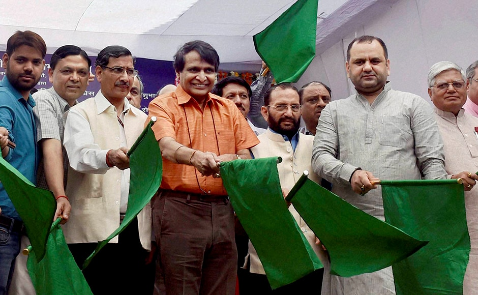 New Delhi: Railways Minister Suresh Prabhu with others at the flag off ceremony of Indiaís first semi-high speed train Gatimaan Express'' in New Delhi on Tuesday. PTI Photo by Kamal Singh