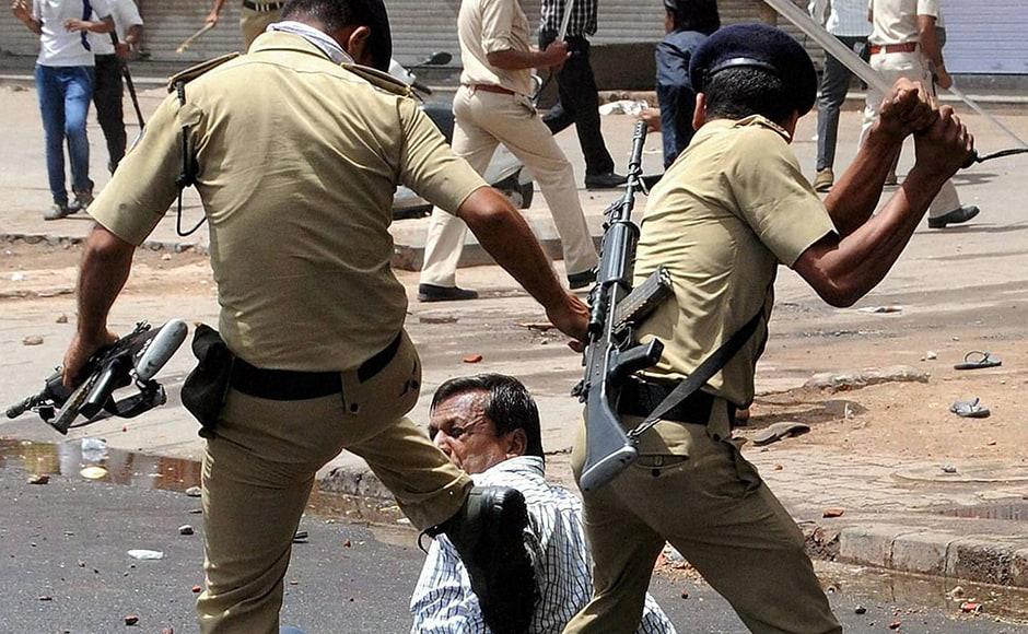 "Cops charge members of the Patidar community during their ""Jail Bharo Andolan"", demanding the release of Hardik Patel in Mahesana on Sunday. PTI"