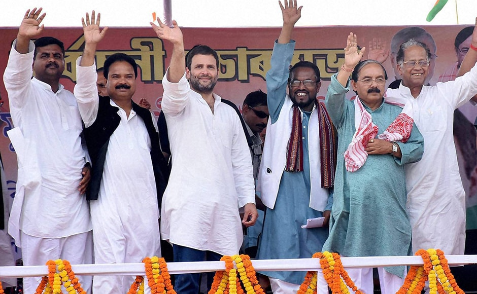 Congress vice president Rahul Gandhi greets supporters during an election rally in Lathima, Assam on Monday. The first phase of the Assembly polls was conducted at 65 constituencies across the state. PTI Photo