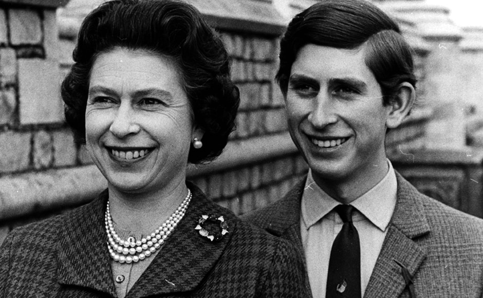 Informal portrait of Prince Charles and his mother, Queen Elizabeth II, in the grounds of Windsor Castle, April 1969. Central Press/Hulton Archive/Getty Images