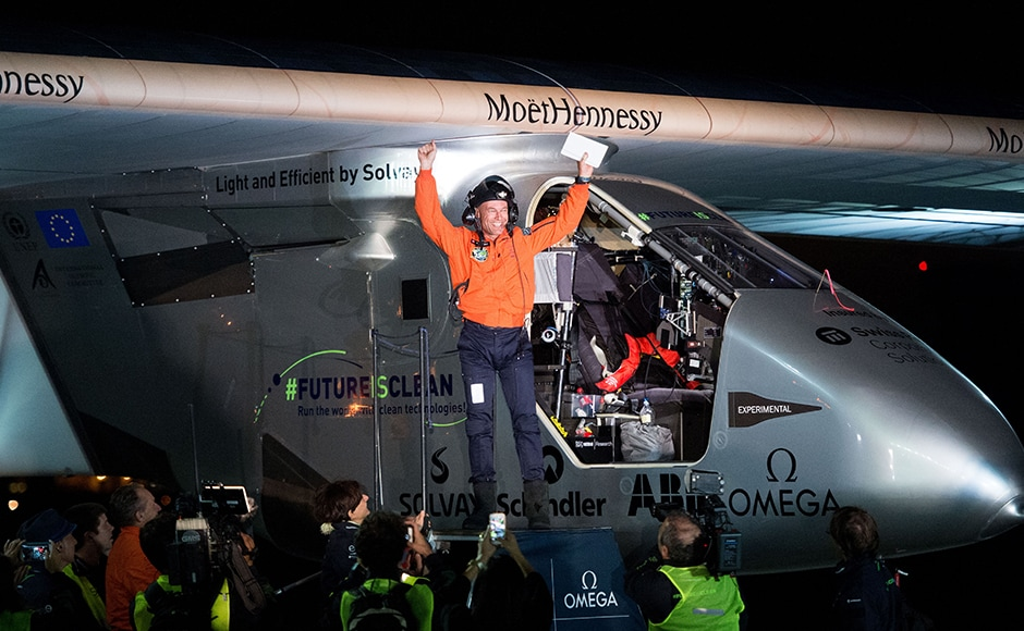 Pilot Bertrand Piccard emerges from Solar Impulse 2 at Moffett Field in Mountain View, Calif., on Saturday, April 23, 2016, after crossing the Pacific Ocean. The solar-powered airplane landed in California on Saturday, completing a risky, three-day flight across the Pacific Ocean as part of its journey around the world. (AP Photo/Noah Berger)