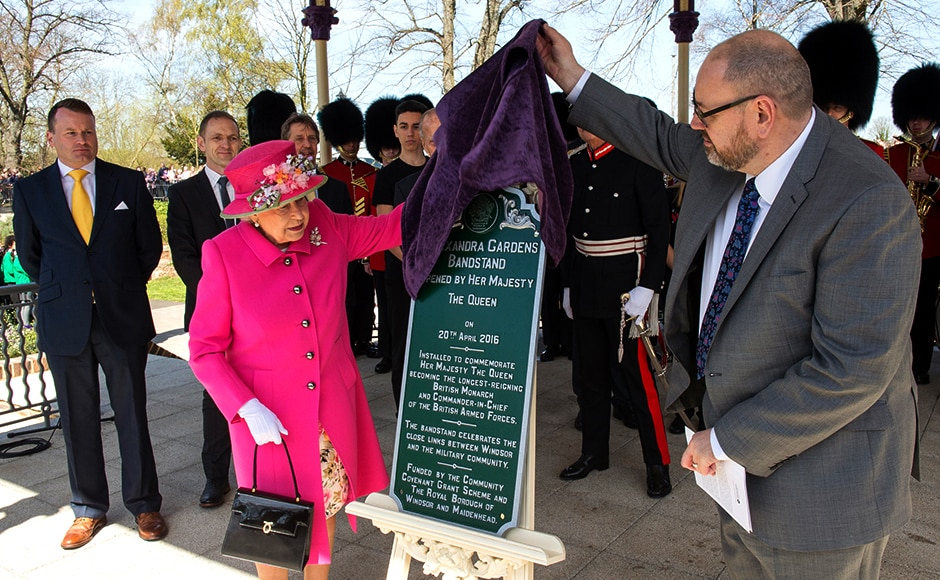 Queen Elizabeth officially opens the new bandstand at Alexandra Gardens. Reuters