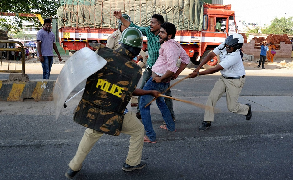 Police beat up the garment workers who were protesting. Faced with violent opposition, the government put on hold the new rules. PTI