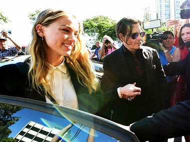 Johnny Depp, center, and Amber Heard, left, arrive at the Southport Magistrates Court on the Gold Coast, Australia on Monday. Dave Hunt/AAP Image via AP