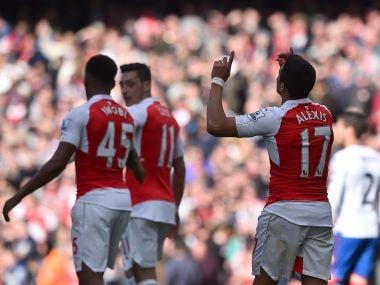 Arsenal's Alexis Sanchez celebrates scoring against  Crystal Palace. AFP